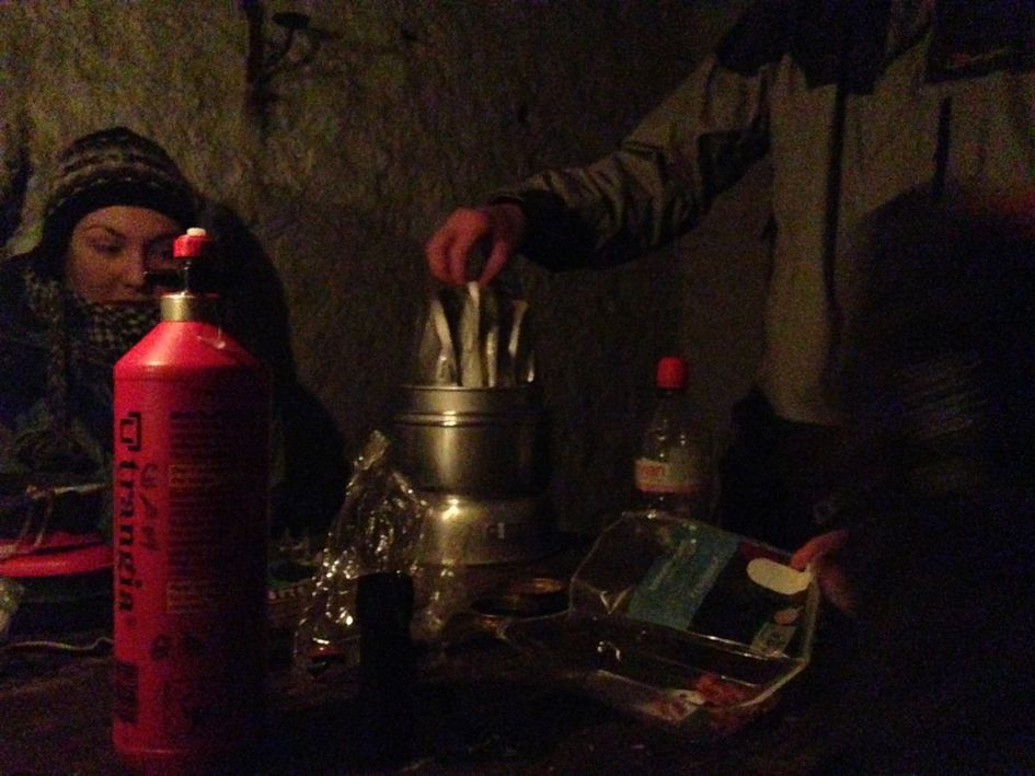 Cooking dinner in the Glas Allt Sheil bothy at Loch Muick