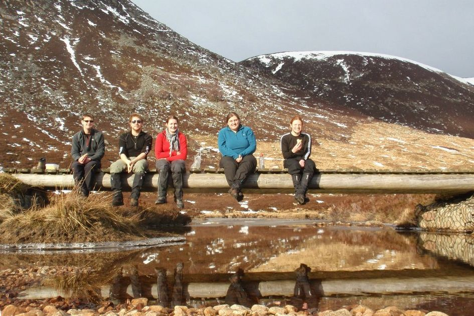 Gordon Network taking a seat on the bridge at Loch Muick in the bright sunshine