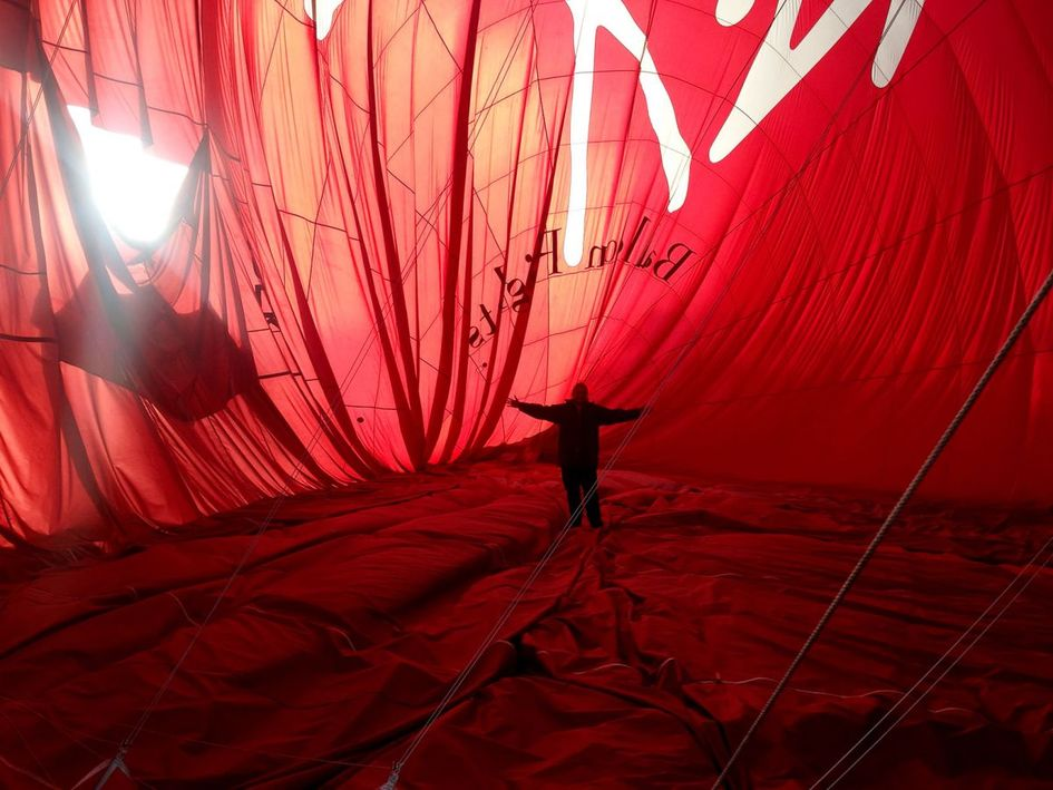 Me standing inside the recently landed hot air balloon envelope. This was an amazing experience.